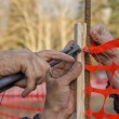 Builder worker Installing Construction Safety Fence 2 — Stock Photo