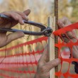 Stock Photo: Builder worker Installing Construction Safety Fence 3