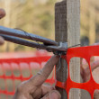 Stock Photo: Builder worker Installing Construction Safety Fence