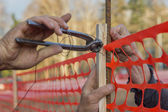 Builder worker Installing Construction Safety Fence 3 — Stock Photo