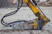 Hydraulic hammer head on building site — Stock Photo