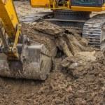 Excavator bucket closeup working — Stock Photo #45691839