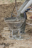 Builder worker filling concrete funnel — Stock Photo