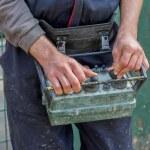Concrete pump operator with remote control for boom pump truck — Stock Photo #47448875