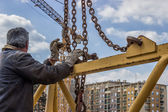 Jib, man installing part of crane construction — Stock Photo