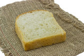 Bread slice with canvas background — Stock Photo
