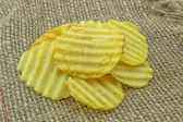 Ribbed yellow potato chips 2 — Stock Photo