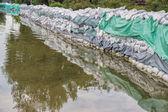Big wall of sandbags for flood defense — Stock Photo