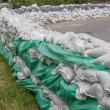 Stacked pile of sandbags for flood defense 2 — Stock Photo #49250481