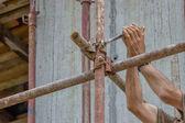 Construction worker hands set scaffold  — Stock Photo