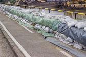 Wall of sandbags for flood defense — Stock Photo
