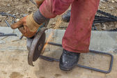 Cutting spacer for the rebar in a concrete post — Stock Photo