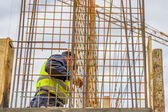 Worker controlling concrete after removing framework — Stock Photo