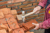 Builder worker cutting a brick 2 — Stock Photo