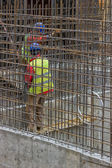 Workers constructing a rebar cage — Stockfoto