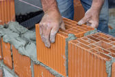 Construction worker laying hollow clay block 2 — Stok fotoğraf