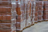 Heap of orange hollow clay block for building construction — Stock Photo