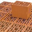 Stacked orange hollow clay block for building construction 2 — Stock Photo #49750577