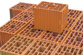 Stacked orange hollow clay block for building construction 2 — Stock Photo