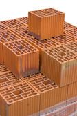 Stacked orange hollow clay block for building construction — Stock Photo