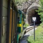 Vintage Railroad Train Enters a Dark Tunnel — Stock Photo #50916259