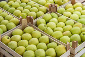 Farmers market apples in a wooden crates — Stock Photo