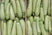 Farmers market marrows in a wooden crates, background — Stock Photo