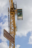 Formwork element against blue sky, lifting by construction crane — Stock Photo