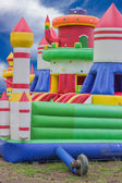 Jumping castle, playground for kids with slides — Stock Photo