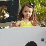 Постер, плакат: Beautiful little girl jokes on the slide