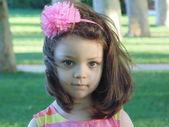 Beautiful little girl looks at mother. — Stockfoto
