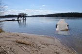 Flooded beach and wood jetty — Foto Stock