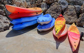 Stacks of colorful kayaks — Stock Photo
