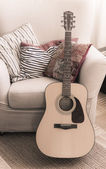 Guitar chair with pillows — Stock Photo