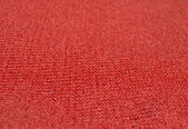 Red wool knitwork selective focus perspective — Stock Photo