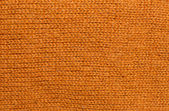 Orange wool knitwork — Stock Photo