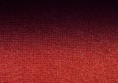 Red wool knitwork fade to black — Stock Photo