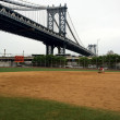 The Manhattan Bridge, New York City. Picture taken from Murray Bergtraum High School baseball field. — ストック写真