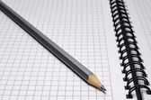 Pencil on notebook — Stock Photo
