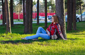 Girl resting under a tree — Stock Photo