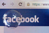 Facebook Logo on ipad screen shot through big water drop — Stock Photo