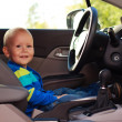 Adorable baby boy in a car — Stock Photo