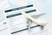 Travel insurance form and   plane model — Stock Photo