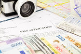 Visa application form, passport, world currency and banknotes  — Stock Photo