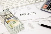 Invoice documents  and dollar money banknotes on office table — Stock Photo