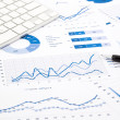 Blue graph and chart reports on office table — Stock Photo #50157075
