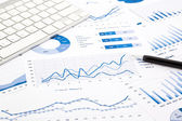 Blue graph and chart reports on office table — Stock Photo
