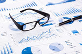 Blue business charts, graphs, document and paperwork — Stock Photo