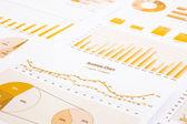 Yellow business charts, graphs, report and summarizing backgroun — Stock Photo