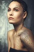 Beautiful young girl with crystals on the body — Stock Photo